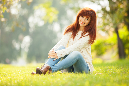 Young pretty woman relaxing in the park Stock Photo - 26947762