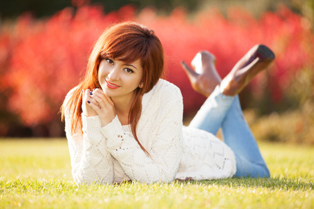 Young pretty woman relaxing in the park Stock Photo - 26947763