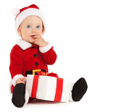 Cute santa baby with beautiful blue eyes on the white background Stock Photo - 26947802