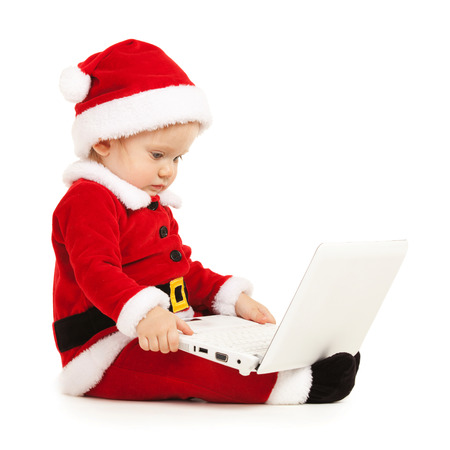 Cute santa baby with laptop on the white background Stock Photo - 26947804
