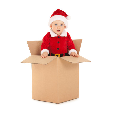 Cute baby-santa with beautiful blue eyes inside the box Stock Photo - 26947807