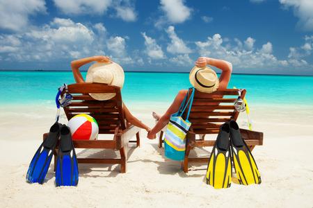 Happy couple on the beach of sea photo