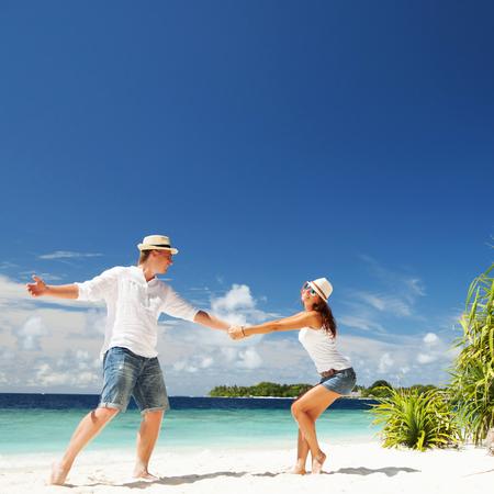 Happy couple on the tropical beach photo