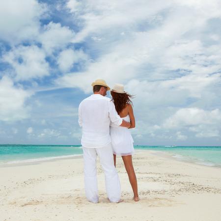 Couple on the beach of sea photo