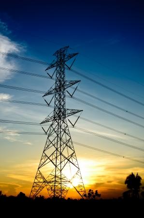 High-voltage tower on twilight background.