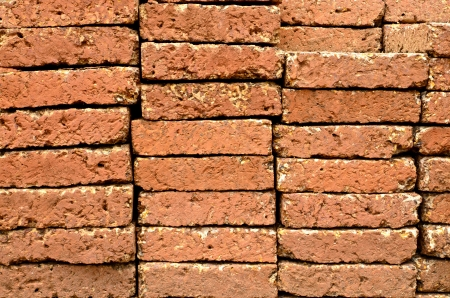 Red-brown brick ( laterite ) wall photo