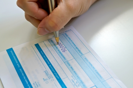 deposit slip: business people writing the pen on deposit slip