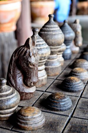 Ancient Thai wooden chess were lined on the board Stock Photo - 21978963