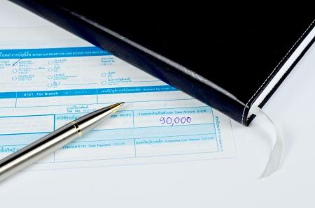 deposit slip: classic pen on deposit slip