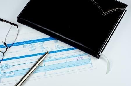 classic pen on deposit slip Stock Photo - 22272099
