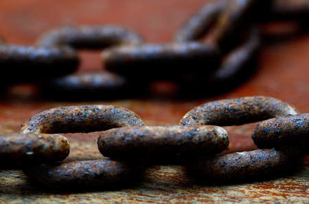 rusty chain on a wooden plank closeup Stock Photo - 24599019