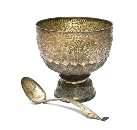 Thai old silver tray with pedestal and ladle Stock Photo