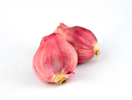 Shallot onions isolated over white background.