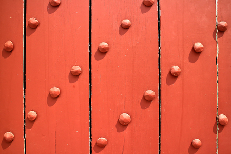 reinforced: old Wooden door, reinforced with metallic bolts. Stock Photo