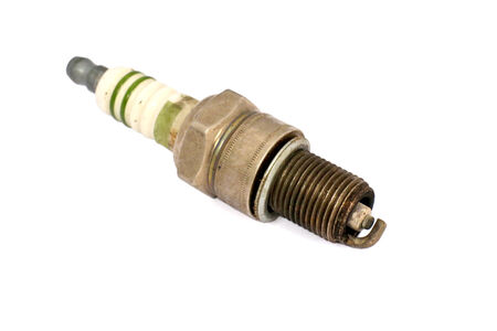 used spark plug on white  Stock Photo
