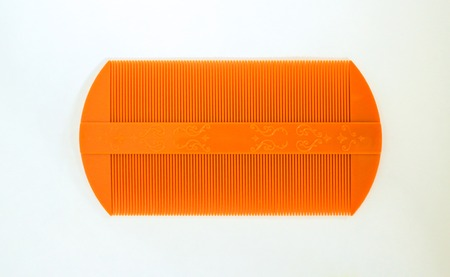 nit: Lice comb isolated on a white background