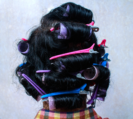 Asia Woman with hair curlers photo