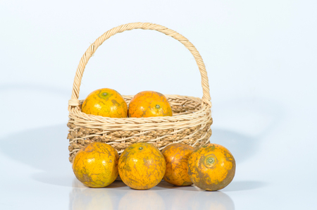 tangerines in a beautiful basket isolated on white Stock Photo