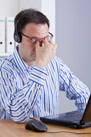 tired customer support operator photo
