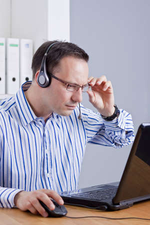 concentrated customer support operator at work photo