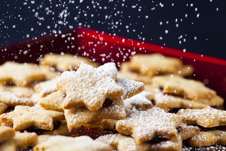 delicious christmas cookies sprinkled with icing sugar photo