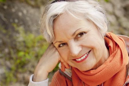 best ager women smiling outdoors Standard-Bild