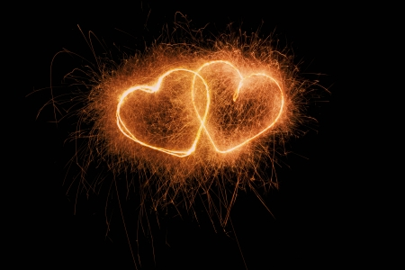 two burning firework hearts from sparklers