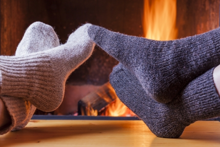 relaxing at the fireplace on winter evening photo