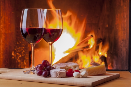 wine glass christmas: delicious cheese and wine at the fireplace