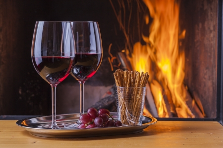 delicious drinks and snack at cozy fireplace