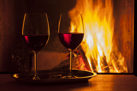 delicious drinks and snack at cozy fireplace photo