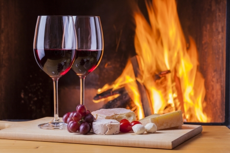delicious cheese and wine at the fireplace Stock Photo - 22553962