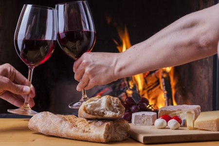 romantic dinner: delicious cheese and wine at the fireplace