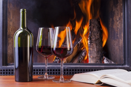 delicious red wine at fireplace photo