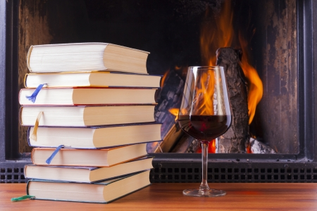 relaxing drinks at cozy warm fireplace in winter photo