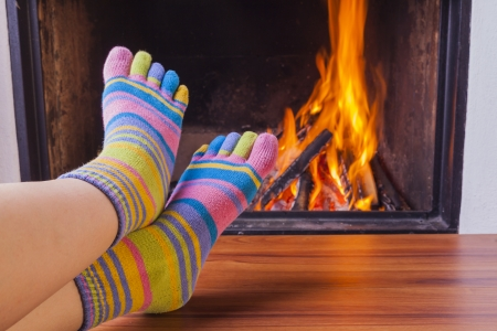 relaxing at fireplace in colorful funny toesocks photo