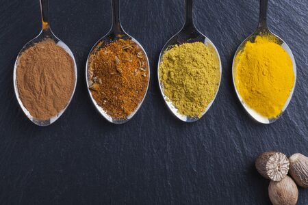 nutmeg: oriental indian spices curry paprika nutmeg on slate Stock Photo