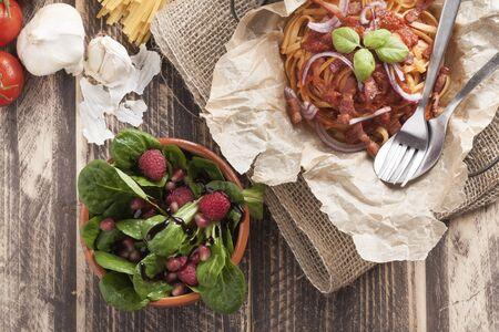 basic food: sphagetti amatriciana italian basic food tomato onion garlic bacon dish on vintage table