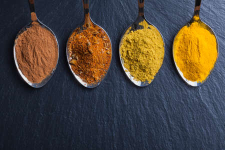 blend: oriental indian spices curry paprika nutmeg on slate Stock Photo