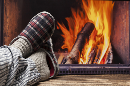 fireplace relax winter fall autumn  rustic dark wooden floor light pyjama Stock Photo