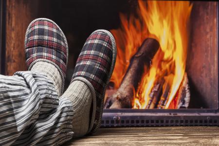 pyjama: fireplace relax winter fall autumn  rustic dark wooden floor light pyjama Stock Photo