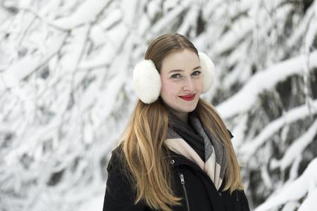 young woman snow walk beauty portrait fun smile candid photo