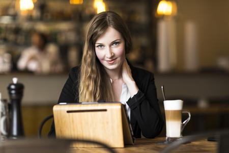 business woman working and surfing the internet at cafe at break