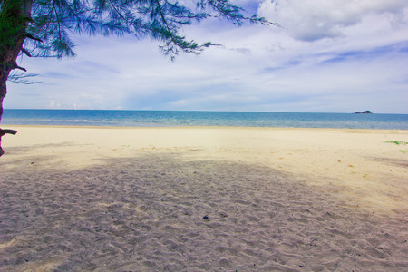 dyllic: a beach is beautiful, the green tree, a sea green water, the sky is blue,