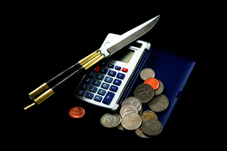butterfly knife: calculator, coins and blade Stock Photo