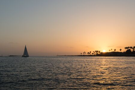 inlet bay: sailboat sailing in bay at sunset in mission bay san diego Stock Photo