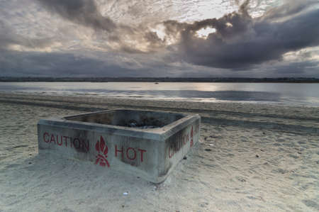 fire pit: fire pit on beach in early morning