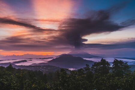 Series of photos from the eruption volcano Agung in Bali with beautiful views of the nature. Big smoke and ash cover the sky