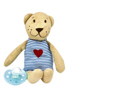 Teddy bear with pacifier - Isolated Stock Photo