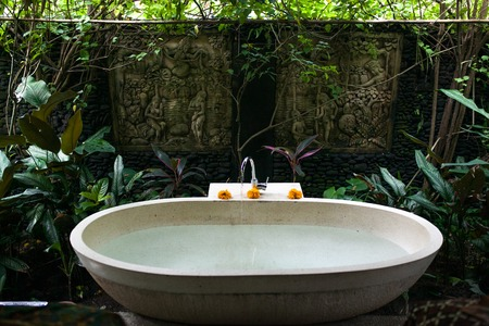 Outdoor bath around tropic greenery for relax.Spa,organic and sk Banco de Imagens
